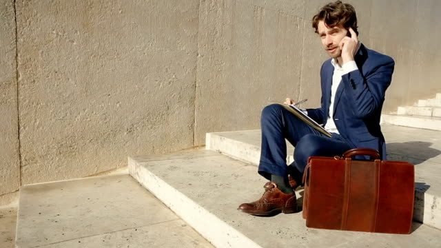 Business person at the telephone with briefcase in Rome