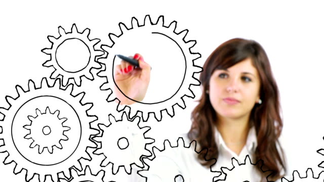 Business person drawing Gears
