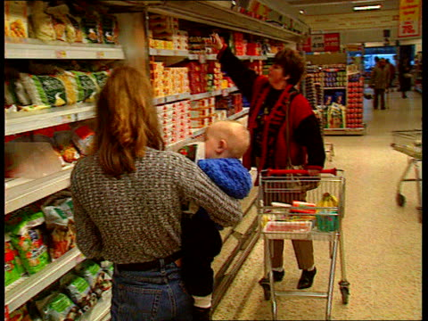 Supermarkets Price Investigation LIB Woman shopping in wines section of supermarket Women shopping in Safeway supermarket LIB Checkouts in Asda...