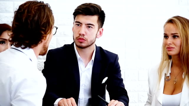 Business team argue over poor performance.