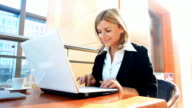 Business woma typing on laptop.