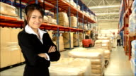 Business Woman And Worker Checking Inventory With Forklift Truck