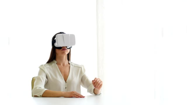 Business woman in glasses working with vr virtual reality