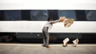 Business woman loses newspaper to passing high speed train