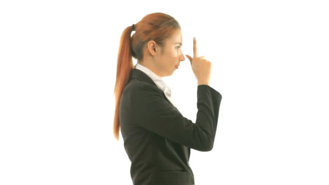 business woman making a gun gesture