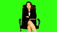 Business Woman Sitting On A Chair With Green Screen Background