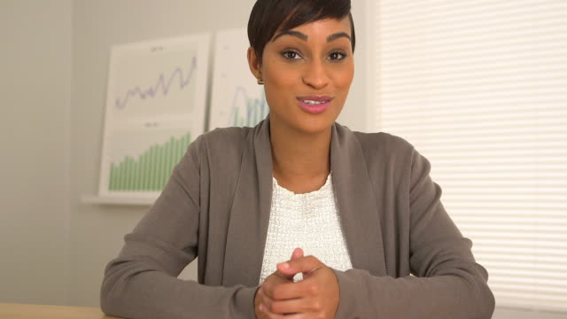 business woman talking directly to camera
