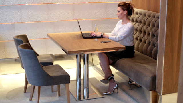 Business woman typing on a laptop and having a campaign