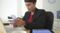 business woman using cell phone and tablet computer