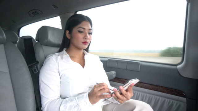 Business woman using digital tablet and smartphone