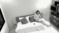 Business woman using digital tablet computer in hotel room
