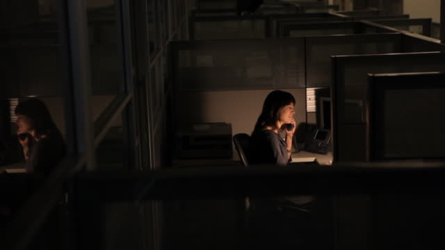 business woman working late in an empty office