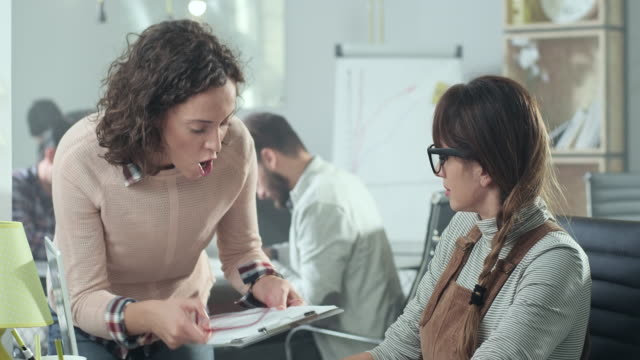 Business woman yelling at colleague