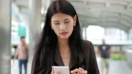 4K : Business women asian using smartphone for relax and shopping online.