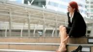 Business women massaging tired legs