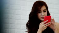 Business women using smartphone for relax and shopping online.