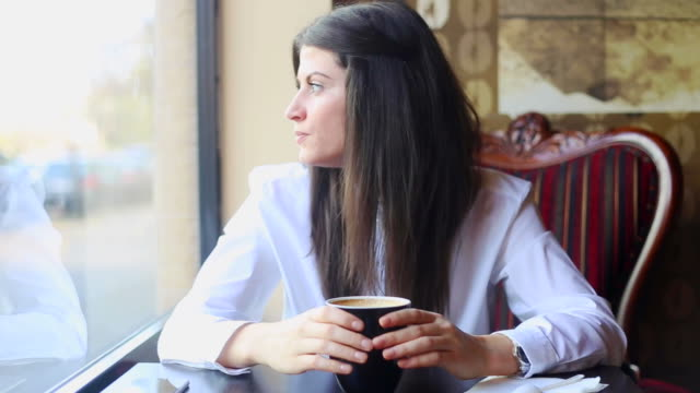 Business young woman drinking her coffee.