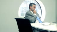 Business_executive_thoughful_in_office_hd.mov