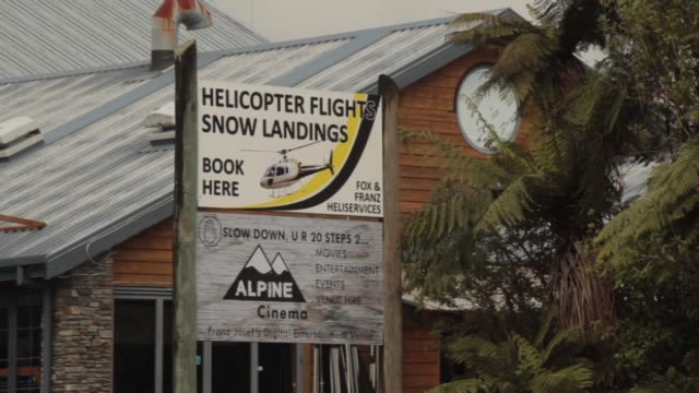 Businesses servicing tourist industry in town of Franz Josef on the West Coast including helicopter tour operator at Alpine Adventure Centre gift...