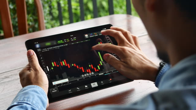 Businessman analysis stock market with digital tablet at home