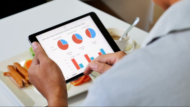 Businessman analyzing market data information on a digital tablet