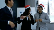 Businessman and businesswoman celebration Christmas and new year in office