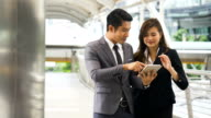 DS MS Businessman and businesswoman meeting outdoor
