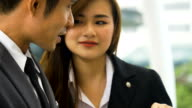 MS CU Businessman and businesswoman meeting outdoor