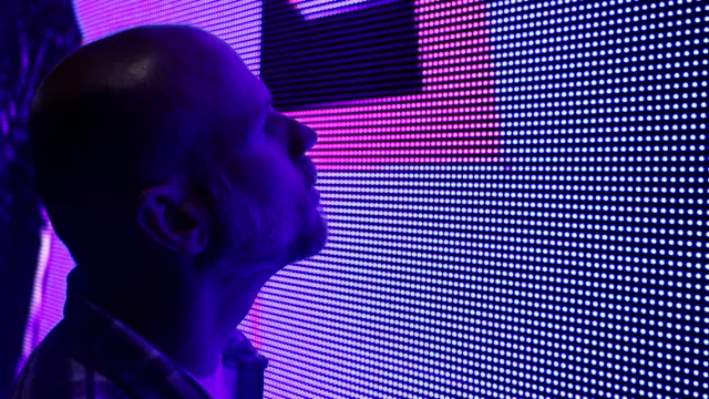 Businessman at Conference Looking at LED Lights