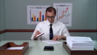 MS Businessman at desk stamping stack of papers, moving them from inbox to outbox/ New York City