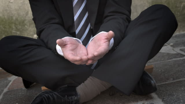 HD DOLLY: Businessman Begging With Open Hands