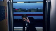 Businessman boarding train