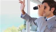 Businessman businessman looking through binoculars while waving