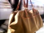 A businessman carrying a bag at a train station Stockholm Sweden.