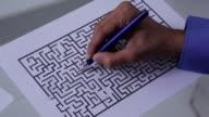 Businessman complete a maze