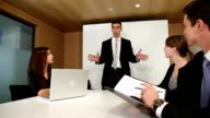 Businessman directing colleagues in meeting
