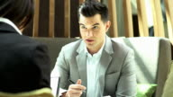 Businessman discuss about there business performance at coffee shop.Business concept