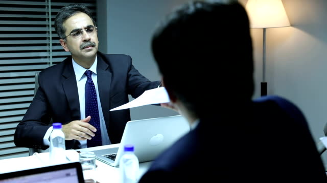 Businessman doing meeting with Colleague in the office, Delhi, India