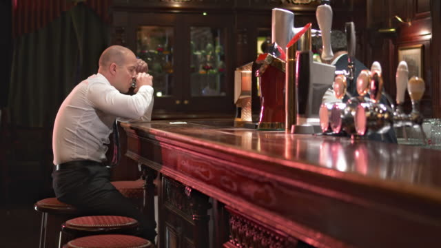 HD DOLLY: Businessman Drinking And Feeling Despair