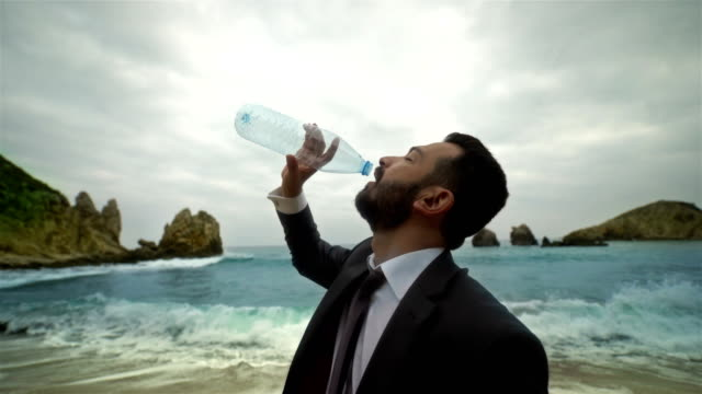 Businessman Drinking Water it's over - 4K Resolution
