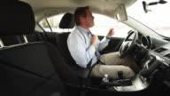 MS Businessman driving car and adjusting tie / Orem, Utah, USA