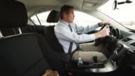 MS Businessman driving car and braking abruptly / Provo, Utah, USA