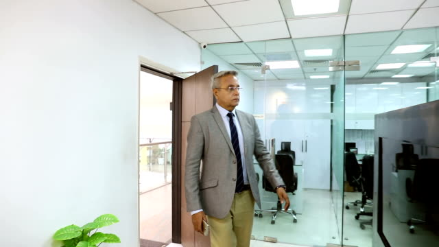 Businessman entering in the office, Delhi, India
