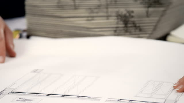 Businessman examine architecture model
