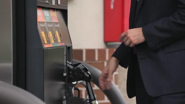 CU TD TU  Businessman filling car with gasoline at gas station / Richmond, Virginia, USA