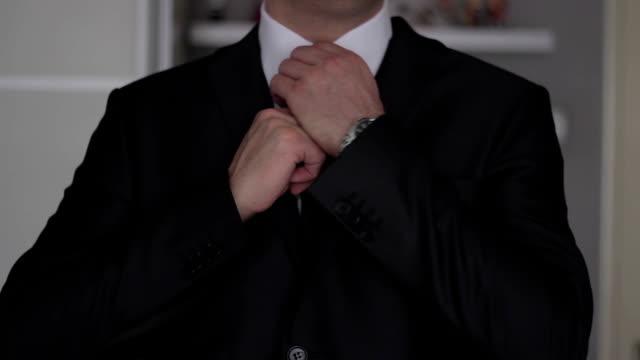 Businessman getting ready for work,yuppi