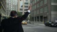 WS R/F Businessman hailing taxi, then getting in and leaving, Tribeca, New York, USA