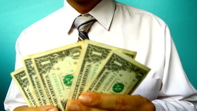 businessman hand hold banknote, US dollar