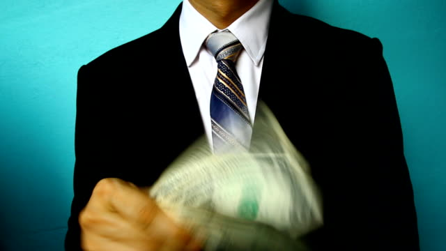businessman hand hold money