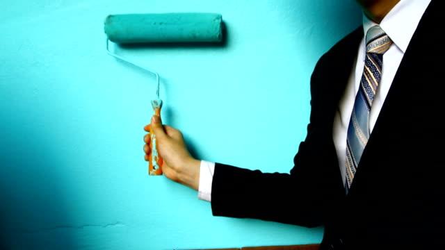 businessman hand hold Paint Roller